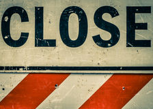 Close Sign. Sign with the word Close and reflective warning stripes Stock Images