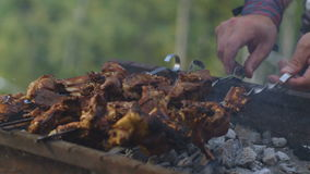 Close Slow Motion Hands Turn Over Kebabs Skewers in Grill Smoke stock footage