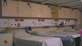 Admission Ward, Africa Mercy, Conakry, Guinea. Close still shot, patients admission ward inside Mercy ship, covered beds, fridge, wall shelves, emergency kits stock video footage