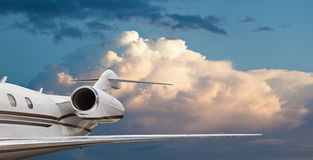 Close tail side view of a private jet flying Royalty Free Stock Photo