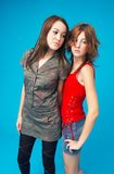 Close Teen Girls. Two teenage girls standing side by side, both looking to their left Stock Images