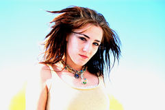 Close of teenage girl with blue sky Stock Image