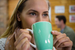 Close of thoughtful woman having coffee in cafe Royalty Free Stock Image