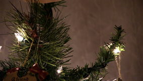Close Tilt Up Christmas Tree Lights And Ornaments stock footage