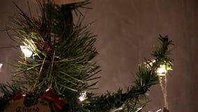 Close Tilt Up Christmas Tree Lights And Ornaments. Close Shot Of Christmas Tree With Lights And Ornaments stock footage