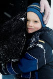 Close to mom on a cold day. A child hugs his mother on a cold day as she holds him close royalty free stock photography