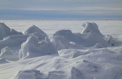 Close to the North Pole. Icy rocks on the frozen sea Stock Photos