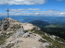 Close to the sky. Typical cross on the very top of White Horn, a 2317 meter high mountain in South Tyrol,  Italian Dolomite Royalty Free Stock Image