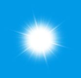Close to the sun. On a blue background Stock Images
