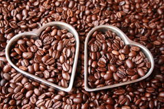 Close of two hearts with coffee beans Royalty Free Stock Photography