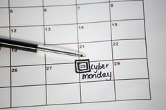 Pen on calender with marked date. Close-u of pen on calender with marked date Stock Photo