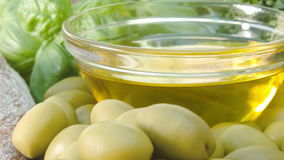 Close-uo of a glass bowl with olive oil stock footage