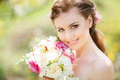 Close uo portrait of  woman in garden Royalty Free Stock Image