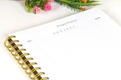 Close up à agenda no planejador de projeto Imagens de Stock Royalty Free