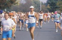 Close-up бегунка во время марафона Стоковое Фото