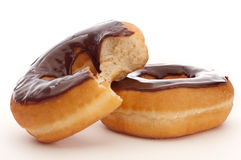 Close up of 2 chocolate donuts Royalty Free Stock Images