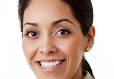 Close Up. Portrait of a professional Hispanic business woman wearing a tan suit looking at camera isolated on white Stock Photography