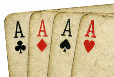 Close up 4 old vintage dirty aces poker cards. Royalty Free Stock Images