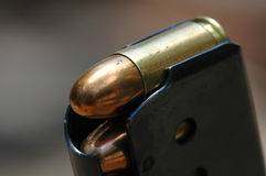 Close-up 9mm caliber bullets. In a charger Stock Photography