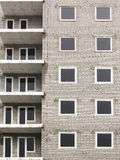 Close up of abandoned apartments building under construction abstract. Block of flats under construction close-up. Building detail, brick wall with windows, as Royalty Free Stock Photo