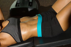 Close-up of the abdominal muscles  fitness woman Royalty Free Stock Image