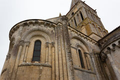 Close-up abse and tower view of Aulnay de Saintonge church. In Charente Maritime region of France Royalty Free Stock Photos