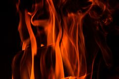 Close up. Abstrack background. Orange flames in the fireplace. Copy space