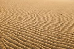 Multiple undulated waves patterns on textured sand dune.. Stock Photography