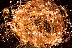 Close-up of abstract Christmas glitter lights ball on xmas tree royalty free stock image