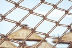 Fishnet fence of a beautiful peaceful beach resort detail royalty free stock photos