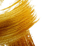 Close up Abstract gold background with acrylic paint brush Stock Photo