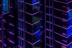 Close-up abstract of pattern of bright purple led backlight walls of high glowing building, modern lighting of buildings. Close-up abstract of pattern of bright royalty free stock photo