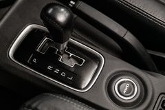 Car interior and detailing. Close-up of the accelerator handle and buttons. Automatic transmission gear of car , car interior stock photography