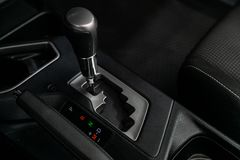 Car interior and detailing. Close-up of the accelerator handle and buttons. Automatic transmission gear of car , car interior royalty free stock photos