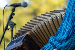Close up of accordion and accordion player playing at Klezmer concert of Jewish music in Regent`s Park in London. Close up of accordion and accordion player in stock photos