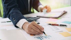 Close up accountant or banker making calculations. Savings, finances and economy concept Stock Images