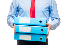 Close-up of an accountant`s hand with a pile of folders Stock Images
