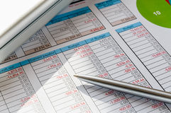 Close Up of an Accounting Module with Pen Royalty Free Stock Photography