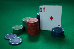 Close-up of aces and chips Stock Photos