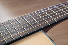 Close up of an acoustic guitar Stock Image