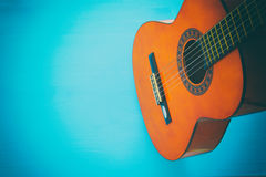 Close up of acoustic guitar against a wooden background stock photography