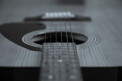 Close up. Acoustic guitar. Black and white , shallow focus. Guitar Strings, close up. Acoustic guitar. Black and white , shallow focus stock photos