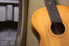 Close-up of acoustic guitar lying on the sofa Stock Images