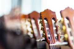 Close up of acoustic guitar necks on blurry background. Concept love music royalty free stock photos