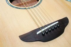 Close up of acoustic guitar strings stock images