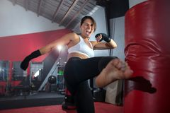 Free Close Up Action Lifestyle Portrait Of An Active Sweaty Athletic Female Mma Fighter Kicking A Bag, Gym Training, Self Defense And E Royalty Free Stock Photos - 161039398