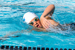 Close up action shot of teen swimmer. Royalty Free Stock Image