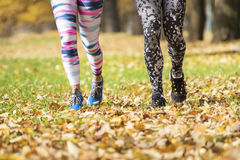 Close up of active couple running at the park. Stock Photography