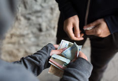 Close up of addict buying dose from drug dealer Royalty Free Stock Photography