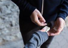 Close up of addict buying dose from drug dealer. Drug trafficking, crime, addiction and sale concept - close up of addict with money buying dose from dealer on Stock Image